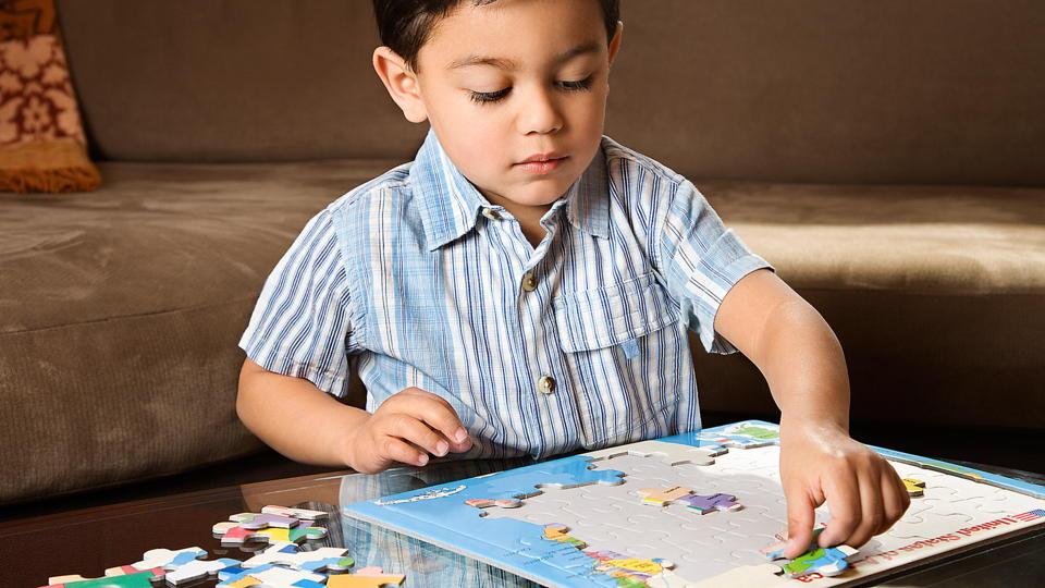 Preschooler with Puzzle